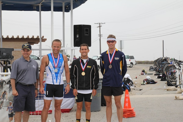 Medalists of the 2013 Armed Forces Triathlon Championship from left to right:  Silver - Maj James Bales (USAF), Keesler AFB, MS - 1:49:57; Gold CPT Nicholas Sterghos (USA), Ft. Hood, TX - 1:49:21; Bronze - LT Thomas Brown (USN), San Diego, CA - 1:50:20