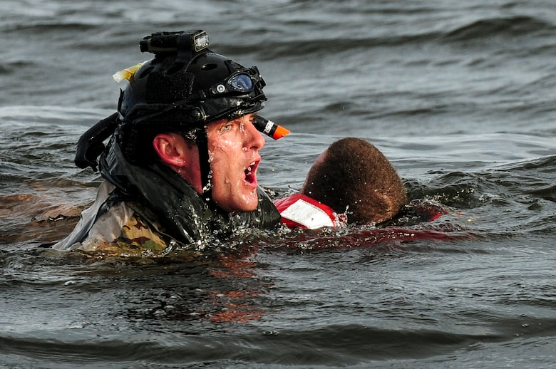 A U.S. Air Force airman from the 23rd Special Tactics Squadron swims to a boat after rescuing a simulated crash victim at Whynnehaven Beach, Fla., April 9, 2013. The 23rd STS trains, equips and employs combat control, pararescue and support personnel in response to presidential and secretary of defense tasks. (U.S. Air Force photo/Airman 1st Class Christopher Callaway)