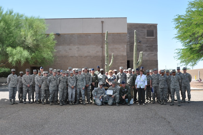 The 612th Air and Space Operations Center was recognized for their contributions to  Tucson's Adopt-a-Street program, June 6. Since March of 2012, the unit has performed more the 220 hours of regular cleanups. (USAF photo by Master Sgt. Kelly Ogden/Released)