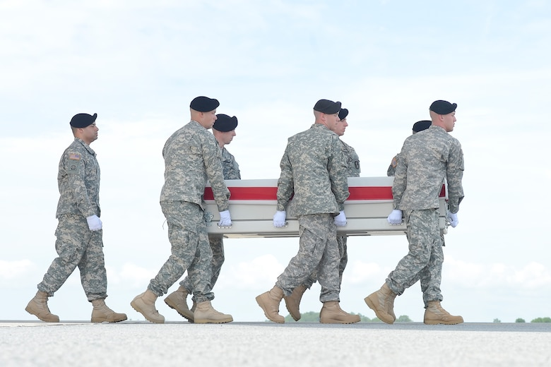 A U.S. Army carry team transfers the remains of Spc. Robert A. Pierce of Panama, Okla., during a dignified transfer June 6, 2013, at Dover Air Force Base, Del. Sisson was assigned to the 1st Battalion, 506th Infantry Regiment, 4th Brigade Combat Team, 101st Airborne Division (Air Assault), Fort Campbell, Ky. (U.S. Air Force photo/Greg L. Davis)