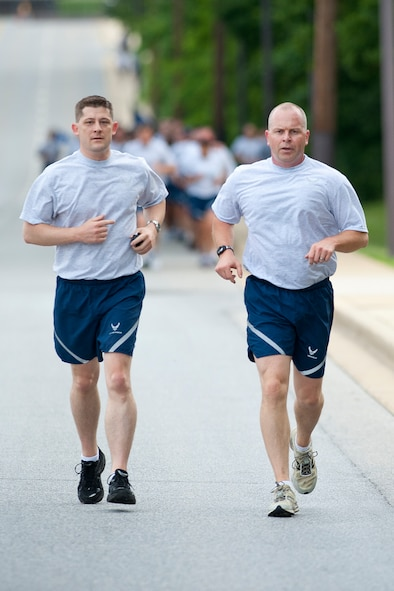 Chief Master Sgt. James Hotaling, Command Chief Master Sergeant of the Air National Guard (right), and Senior Master Sgt. Robert Vance, superintendent of Executive Services at the ANG Readiness Center, Joint Base Andrews, Md., participate in a D-Day memorial run at Joint Base Andrews, Md. June 6, 2013. The group run designed to build teamwork and camaraderie between members of the Army National Guard and Air National Guard marked the 69th anniversary of the allied invasion of Western Europe in World War II. (U.S. Air National Guard photo by Master Sgt. Marvin R. Preston/RELEASED)