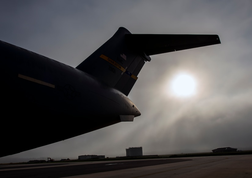 Fog rolls across the Joint Base Charleston flightline as the sun rises above A C-17 Globemaster III June 4, 2013 at JB Charleston – Air Base, S.C. The first C-17 to enter the Air Force's inventory arrived at Charleston Air Force Base in June 1993. The C-17 is capable of rapid strategic delivery of troops and all types of cargo to main operating bases or directly to forward bases in the deployment area. (U.S. Air Force photo/Senior Airman Dennis Sloan)