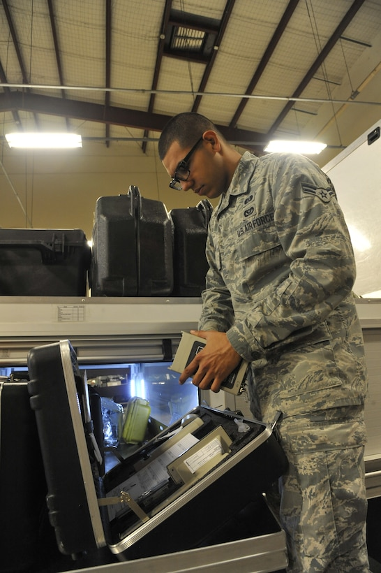 Airman 1st Class Alfredo Guzman, 509th Civil Engineer Squadron journeyman, performs an operation check on the ADM-300 at Whiteman Air Force Base, Mo., May 22, 2013.This equipment is used to measure levels of radiation, and is inspected every week to ensure proper functioning. (U.S. Air Force photo by Airman 1st Class Keenan Berry/Released)