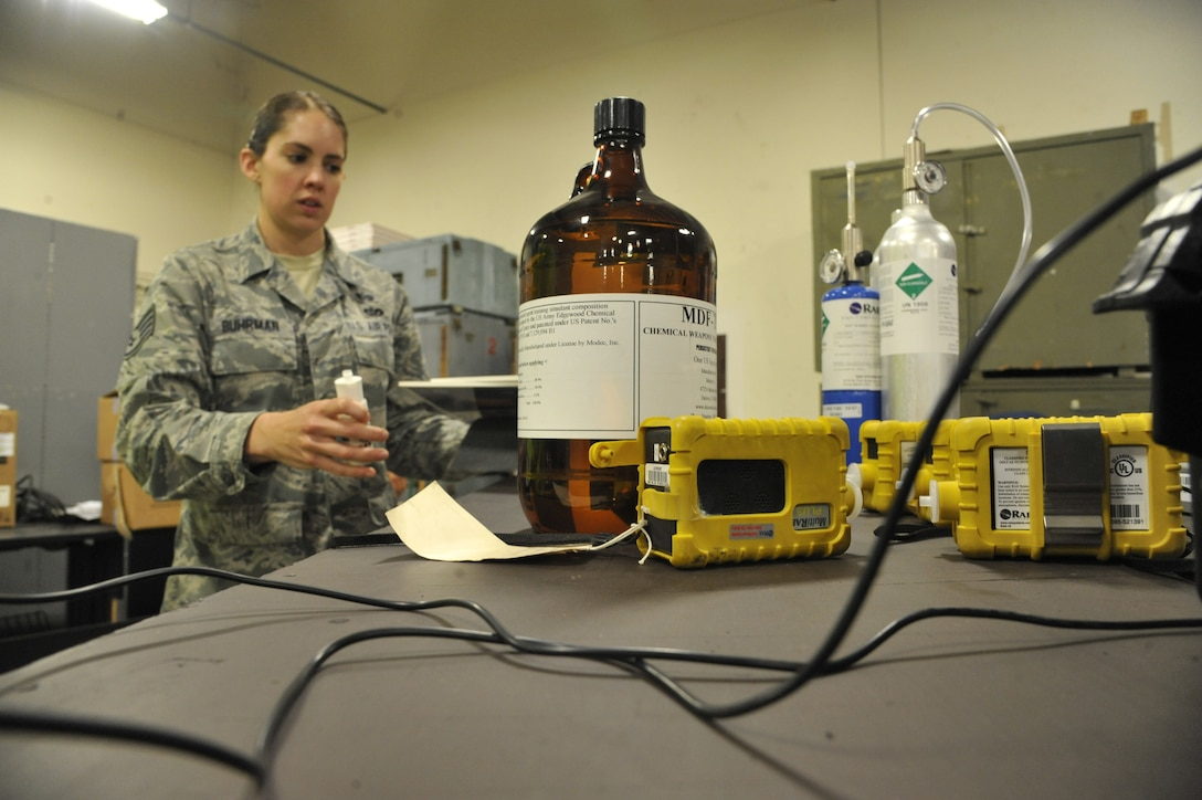 Staff Sgt. Rebecca Buhrman, 509th Civil Engineer Squadron NCO in charge of emergency management logistics, gathers powders and liquids at Whiteman Air Force Base, Mo., May 22, 2013. These liquids and powders are used for training purposes to ensure emergency management team readiness. (U.S. Air Force photo by Airman 1st Class Keenan Berry/Released)