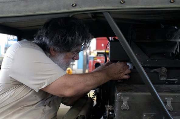 DAYTON, Ohio (06/2013) -- Volunteer Larry Youngblood tries out a fabricated part on the M151 Jeep. (U.S. Air Force photo)