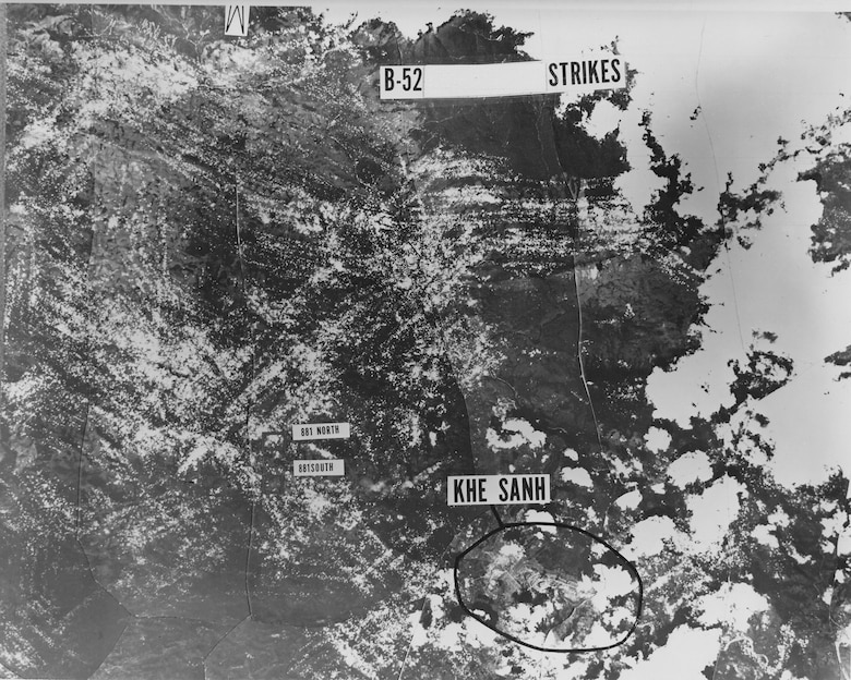 The intensive B-52 bombardment of enemy forces at Khe Sanh was shown by this montage pieced together from reconnaissance photos. White dots indicate where bombs fell (white areas on right show cloud cover). The heavy saturation of pock marks in the enemy-held area above Khe Sanh shows the remarkable accuracy of the B-52s. (U.S. Air Force photo)