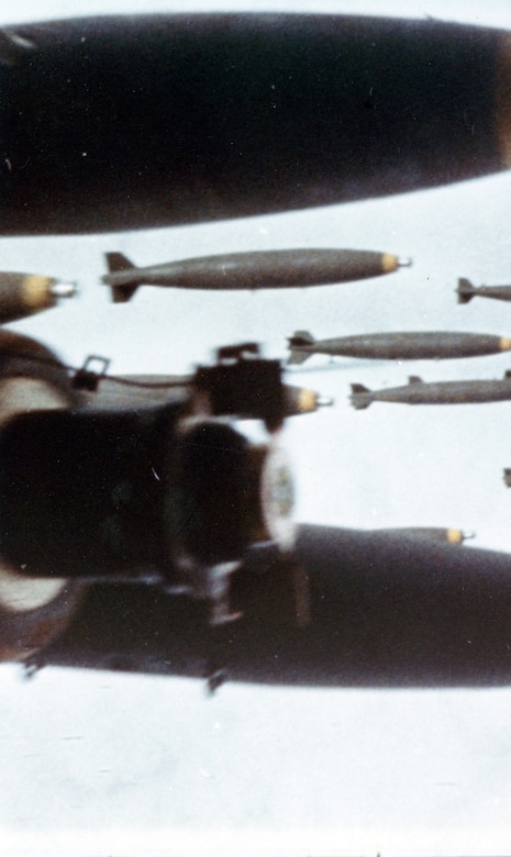 "As seen from another aircraft, bombs released from a B-52 fall on communist forces attacking Khe Sanh. The aerial bombing campaign in support of the besieged American forces at Khe Sanh was named OPERATION NIAGARA for this ""waterfall"" of bombs. (U.S. Air Force photo)"