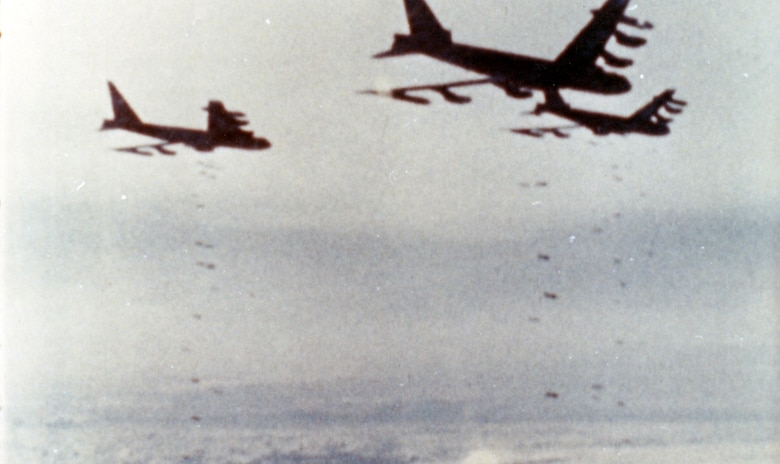 "Air Force B-52s drop their loads of bombs on a close air support mission over Khe Sanh. Even from very high altitudes, they could accurately place their bombs within one-sixth of a mile of the besieged American forces. The aerial bombing campaign in support of the besieged American forces at Khe Sanh was named OPERATION NIAGARA for this ""waterfall"" of bombs. (U.S. Air Force photo)"