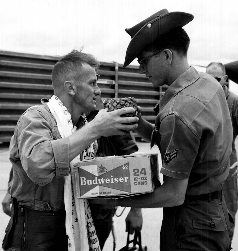 Retired U.S. Air Force Lt. Col. Harry Pawlik accepts gifts after his final flight at Korat Air Base, Thailand in Aug. 1967. Pawlik commissioned into the Air Force as a fighter pilot in 1955 and retired in 1980. He flew seven different aircraft at 12 different Air Force bases. (Courtesy Photo)