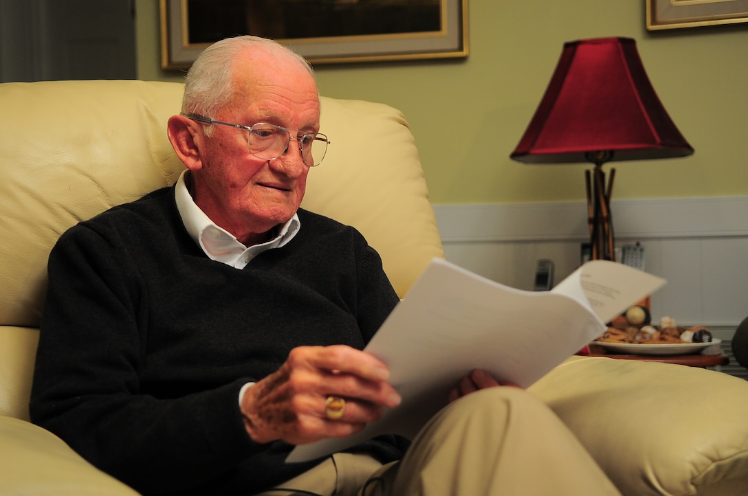 U.S. Air Force retired Lt. Col. Harry Pawlik reviews a speech written in his honor at his home in Greenville, N.C., Jan. 3, 2013. Pawlik, a World War II concentration camp survivor, recalled several obstacles from the time he was captured by Nazi forces at the age of 10, to the day he graduated from the Naval War College during a recent interview. (U.S. Air Force photo/Airman 1st Class Aubrey White/Released)