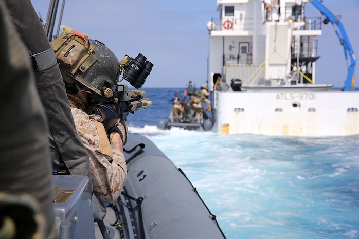 Members of 1st Marine Special Operations Battalion practice boarding and searching ships. Marines train for Visit, Board, Search and Seizure (VBSS) at the highest level. This type of interdiction involves a non-compliant ship, underway, and opposed.