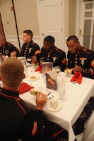 Headquarters Company Marines eat the first course during the non-commissioned officers Mess Night dinner aboard Marine Corps Base Quantico on June 5, 2013. Over forty Marines attended the commemorative event.