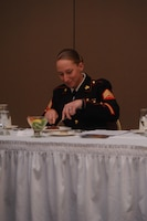"Sgt. Stephany Rector, president of the mess, tastes the beef before declaring it fit to serve to the ""mess"" during the Headquarters Company Mess Night aboard Marine Corps Base Quantico on June 5, 2013. The taste test was one of several Marine Corps traditions that are a part of the ceremonial dinner"