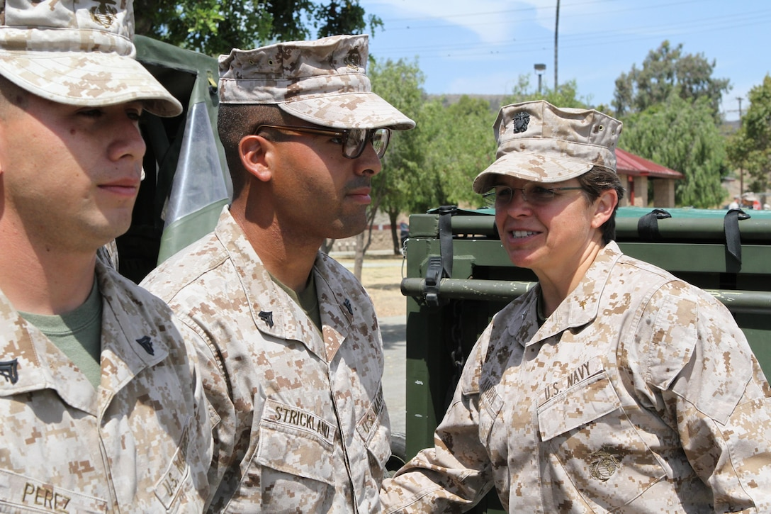 Navy Rear Admiral Margaret Kibben, chaplain of the Marine Corps, thanks the Marines of Quebec Battery, 5th Battalion, 11th Marine Regiment, for taking pride in their work when she visited Marines here, Aug. 15. Kibben said she was impressed with how well the Marines of Quebec Battery retained information concerning their jobs.