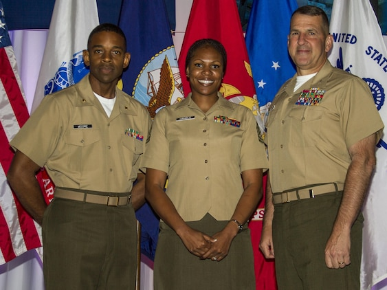 Gunnery Sgt. Tawanda Hanible, diversity operations chief, Marine Corps Recruiting Command (center) takes a picture with Maj. Frank Moore, diversity officer, MCRC, and Col. Robert G. Golden III, chief of staff, MCRC, during the Sea Service Leadership Association's Joint Leadership Awards Luncheon at the Gaylord National Resort and Conference Center here, June 6. Hanible received the Major Megan McClung Leadership Award during the luncheon.