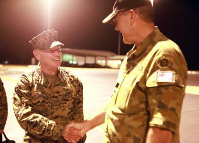 Lt. Gen. Kenneth Glueck, Jr. (left), commanding general, III Marine Expeditionary Force, shakes hands with Air Commodore Ken Watson (right), commander, Northern Command, Royal Australian Air Force, after landing here, May 27. Glueck flew to Australia to visit MRF-D Marines and tour surrounding military facilities.