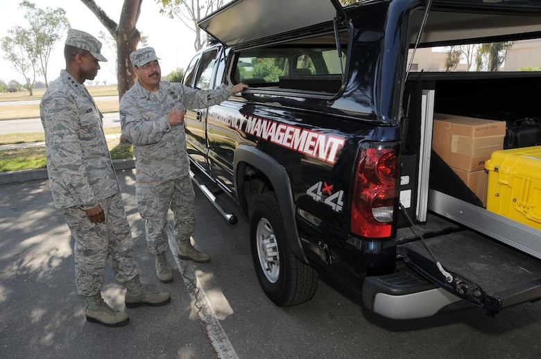 Lt. Gen. Darren McDew commander of the 18th Air Force is briefed by Senior Master Sgt. Oscar Soto of the 146th Emergency Management office, California Air National Guard,  on the capabilities of the crash response truck his office assembled on May 11, 2013. McDew?s visit was part of an overall familiarization tour of the missions and facilities at the 146th Airlift Wing, California Air National Guard, Port Hueneme, Ca. Air National Guard photo by Master Sgt. Dave Buttner