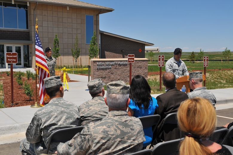Maj. David Haigh, 460th Security Forces Squadron commander, challenges his Airmen to earn their new building at the 460th Security Forces Squadron ribbon-cutting ceremony June 6, 2013, on Buckley Air Force Base. The 460th SFS was previously housed in one of the oldest buildings on Buckley, and are now located in a state-of-the-art facility. (U.S. Air Force photo by Senior Airman Phillip Houk/Released)