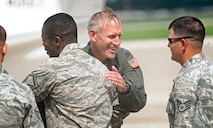 Col. David Almand, 375th Air Mobility Wing commander, is congratulated by the Airmen he has commanded over the past year following his fini-flight as wing commander at Scott Air Force Base, Ill. June 6, 2013. A commander's fini-flight is an Air Force tradition meant to honor and thank the commander for his service. Almand will relinquish his command of the 375th at a change of command ceremony 14 June, 2013.(U.S. Air Force photo/ Staff Sgt. Ryan Crane)
