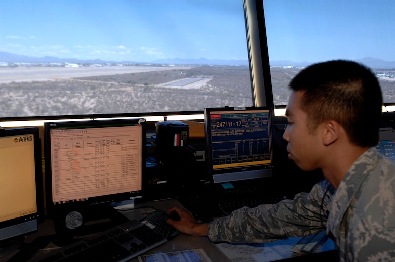 U.S. Air Force Airman 1st Class Danny Ho, 355th Operations Support Squadron air traffic controller, checks the Airfield Automated System from the cab of the air traffic control tower at Davis-Monthan Air Force Base, Ariz., June 4, 2013. The automated system acts as a status board, allowing controllers to view essential information such as aircraft positions on the flightline and wind speeds. (U.S. Air Force photo by Airman 1st Class Saphfire Cook/Released)
