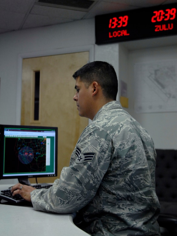 U.S. Air Force Senior Airman Ralph Ruiz, 355th Operations Support Squadron base operations, checks the computer system at Davis-Monthan Air Force Base, Ariz., June 4, 2013. The map on his computer screen allows base ops to keep track of all inbound and outbound aircraft for D-M. (U.S. Air Force photo by Airman 1st Class Saphfire Cook/Released)
