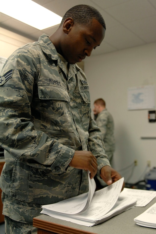 U.S. Air Force Senior Airman Tyrone Hobbs, 355th Operations Support Squadron flight records, separates paperwork to be placed in squadron members' Annual Products at Davis-Monthan Air Force Base, Ariz., June 4, 2013. An Annual Product is a collection of records, such as flying hours, that is compiled by flight records and reviewed by squadron members once a year. (U.S. Air Force photo by Airman 1st Class Saphfire Cook/Released)