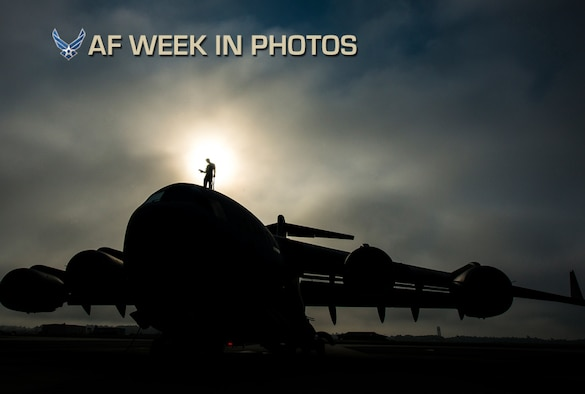 Tech. Sgt. Andrew Gravett walks along the top of a C-17 Globemaster III while wearing a safety harness as he does a routine maintenance check of the aircraft June 4, 2013, at Joint Base Charleston, S.C. The first C-17 to enter the Air Force's inventory arrived at Charleston Air Force Base in June 1993. The C-17 is capable of rapid strategic delivery of troops and all types of cargo to main operating bases or directly to forward bases in the deployment area. Gravett is a crew chief assigned to the 437th Aircraft Maintenance Squadron. (U.S. Air Force photo/Senior Airman Dennis Sloan)