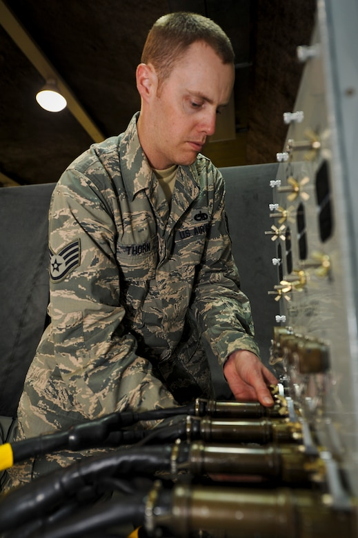 Staff Sgt. Jesse Thorn prepares a C-17 Globemaster III flight control computer for testing, June 5, 2013, at the 379th Air Expeditionary Wing in Southwest Asia. Thorn is a 379th Expeditionary Maintenance Squadron C-17 avionics technician deployed from Joint Base Lewis-McChord, Wash. (U.S. Air Force photo/Senior Airman Benjamin Stratton)