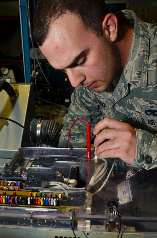 Senior Airman Benjamin Wagner ensures the serviceability of an electron tube within a target indicator of a B-1B Lancer's avionics assembly, June 5, 2013, at the 379th Air Expeditionary Wing in Southwest Asia. This process is accomplished to improve the picture quality, resolution and brightness of the avionics equipment. Wagner is a 379th Expeditionary Maintenance Squadron B-1B avionics technician deployed from Ellsworth Air Force Base, S.D. (U.S. Air Force photo/Senior Airman Benjamin Stratton)