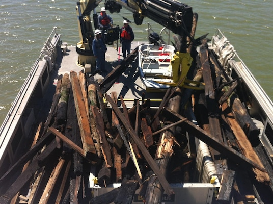 Debris on the decks of SPN debris removal vessels.