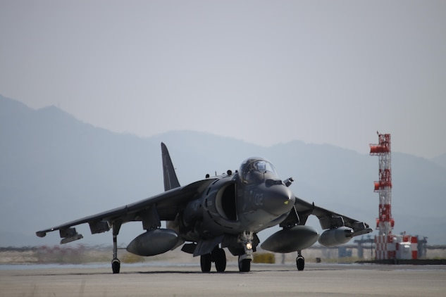 An AV-8B Harrier II aircraft from Marine Attack Squadron 513 prepares to take off from Marine Corps Air Station Iwakuni, Japan, to Kadena Air Base, Okinawa, Japan, May 24, 2013. VMA-513 conducted their last flights before their deactivation slated July 13,2013.