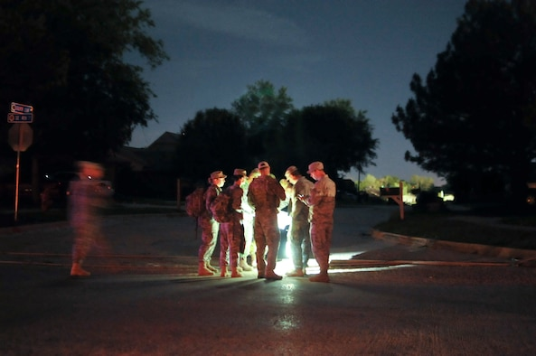 Oklahoma Army and Air National Guard conduct a shift change at a checkpoint during the night in Moore, Okla., May 22, 2013. Joint military rescue, relief and security efforts have been deployed by Oklahoma's governor, Mary Fallin, after the devastating tornado that struck May 20, 2013. (U.S. Air Force Photo by Staff Sgt. Caroline Hayworth/Released)
