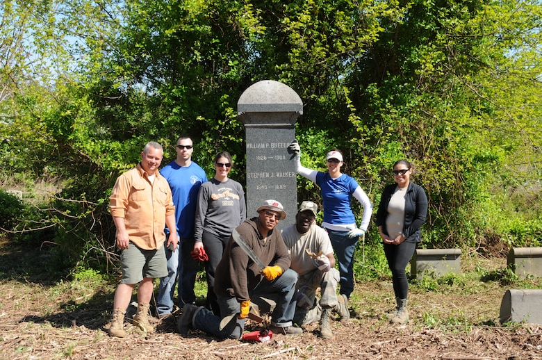 Volunteers from the 111th Fighter Wing spent the day at Mount Moriah Cemetery in Philadelphia cleaning away years of overgrown plants and trash from the site on May 3. Mount Moriah, at 380 arces, is the largest cemetery in Pa., but has fallen into a state of neglect. Shown left is Master Sgt. Scott A. Cline, LRS fuels delivery, Capt. Steven K. Good, logistics readiness officer, Capt. Nicole Reigelman, AOG public affairs officer, Master Sgt. Sterling Randolph, Communications Flight, Master Sgt. Sylvester Fisher, AOG, Capt. Danielle Minamyer, wing plans officer and 2nd Lt. Belitza Hernandez, equal opportunity office.