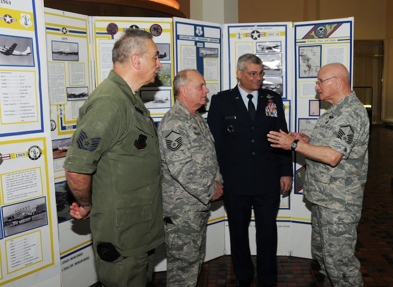 Members of the 111th Fighter Wing historical office participated in the annual Guard Day at the Capitol event held at the Pennsylvania state capitol building in Harrisburg, Pa. on April 17. The event attended by Pa. Air and Army Guard units from across the state, offers the opportunity to legislators and capitol visitors to learn about the diverse state and federal missions performed Pa. Guardsmen. Air Deputy Adjutant General, Col. Anthony Carrelli, right-center, talks 111th Fighter Wing history with retired Tech. Sgt. Rich Ciborowski , left, retired Master Sgt. Larry Glemser and retired Master Sgt. Jim Waibel.