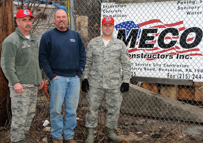 On Feb. 1, Meco Constructors Incorporated of Bensalem, Pa. donated building materials to the 201st RED HORSE, Detachment 1 to enhance the training facility being built here. Ed Lounsberry, heavy equipment maintenance foreman with Meco Constructors, center, Master Sgt. Robert Ipri, left, and Master Sgt. Geoffrey Gay, supervisors with the 201st, spend the cold and snowy day hoisting numerous four-foot diameter cement sewer pipes on flatbed trucks, destine for Horsham Air Guard Station. The training facility, located on the former aircraft ramp area, is expected to be completed in March said Ipri.