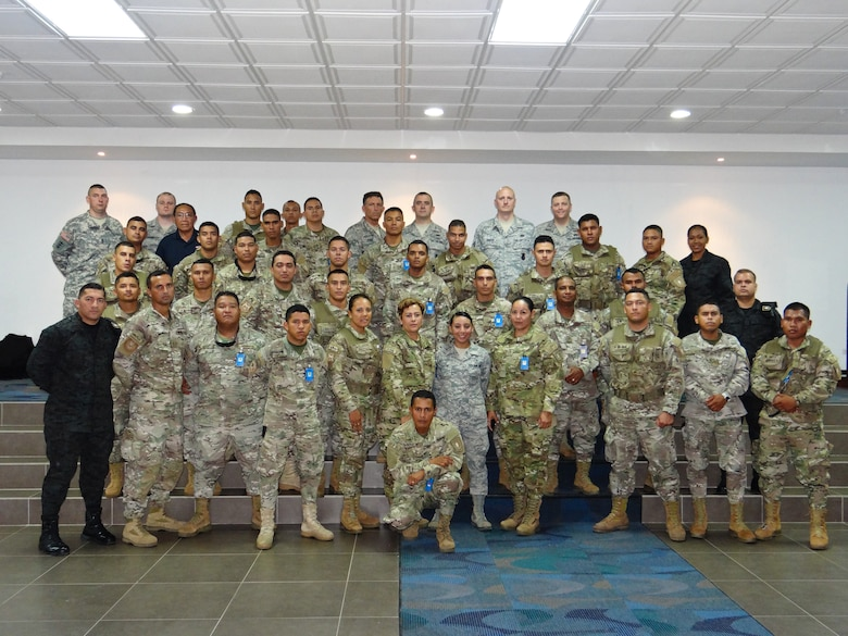U.S. Airmen assigned to the 139th Security Forces Squadron, Missouri Air National Guard, pose for a photo with service members of  the Panamanian Public Forces (PPF) in Panama City, Panama, May 16, 2013. SFS Airmen conducted an exchange of information with the PPF. (U.S. Air National Guard photo provided by Airman 1st Class Marina Salazar/Released)