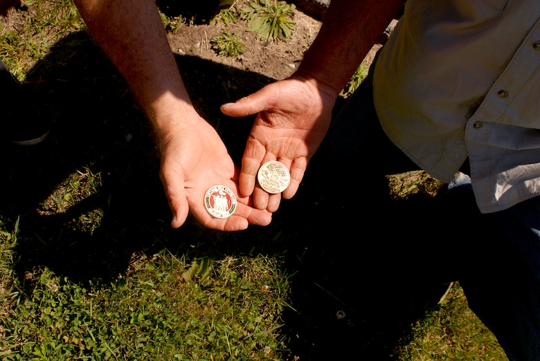 Holliker, hold the special military challenge. The intent is to give the coins to Vietnam veterans, so they may give them to their children. Holliker designed the coin to represent the Vietnam era. Photo by Master Sgt. Elizabeth Holliker, Public Affairs (Released).