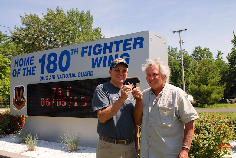 Mr. Duke Wheeler and retired U.S. Air Force Lt. Col. Bob Holliker, the men behind the design and production of the special Military Brat challenge coins. The intent is to give the coins to each veteran attending the events in June so that they may present the coins to their children as a sign of their appreciation. Photo by Master Sgt. Elizabeth Holliker, Public Affairs (Released).
