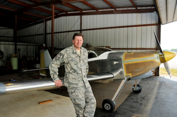 Chief Master Sgt. Jeff Trabold, 180th FW Airfield Operations Manager, pictured with his hand built Vans Aircraft RV-6. The aircraft took around 22 years to complete and was funded with Chief Trabold's guard checks. Photo by Staff Sgt. Nicholas Kuetemeyer, Public Affairs (Released).