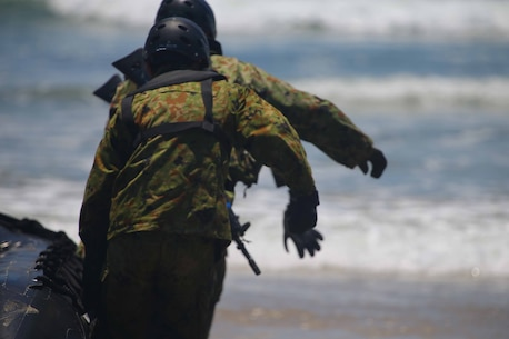 Members of the Japanese Self Defense force prepare to leave the beach during Combat Rubber Rating Craft, better known as CRRC, training here June 4. The purpose of the training was to teach the Japanese forces how to execute amphibious operations from ship to shore.  This training is part of exercise Dawn Blitz, which is mulitnational amphibious exercise that refocuses Navy and Marine Corps and coalition forces in their ability to conduct complex amphibious operations essential for global crisis response across the range of military operations.