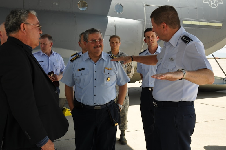 Air General Jaime Figueroa, Commanding General, Peruvian Air Force and Lt. Gen. Robin Rand, 12th Air Force (Air Forces Southern) commander, discuss the capabilities of a C-130J here, June 10. The Peruvian Air delegation is at D-M for discussions relating to building partnership capacity, countering transnational organized crime, and humanitarian assistance and disaster response in the U.S. Southern Command area of responsibility (USAF photo by Master Sgt. Kelly Ogden/Released).