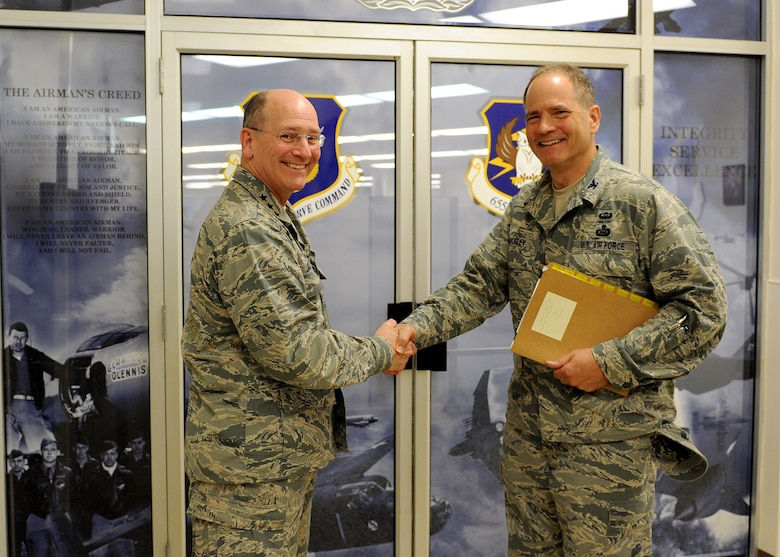 "Lt. Gen. James ""JJ"" Jackson, Air Force Reserve Command commander, greets Col. Douglas Drakeley, 655th ISR Group commander, during a recent visit to the tour the new group. (U.S. Air Force photo/Staff Sgt. Veronica A. Pierce)"