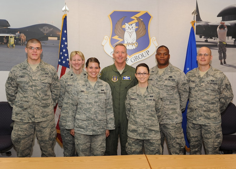 These members received coins from Maj Gen Bill Binger from for their participation in standing up the newest ISR group. From left to right are: Senior Airman Steven Power, Lt. Col. Audrey Swinney, Senior Airman Laura Vance, Maj. Gen. Binger, Senior Airman Sharlota Sorenson, Senior Airman Joshua Walker and Staff Sgt. Eli McPheron. (U.S. Air Force photo/Staff Sgt. Veronica A. Pierce)