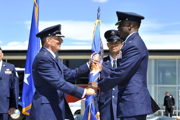Lt. Gen. Mike Gould (left) hands Col. Stacey Hawkins the guidon during the 10th ABW Change of Command ceremony June 10 at the Air Force Academy. (U.S. Air Force Photo/Raymond McCoy)