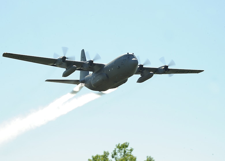 """An Air Force Reserve aircrew flying a C-130 Hercules assigned to the 910th Airlift Wing, Youngstown Air Reserve Station, Ohio, sprays a mosquito egg sanitation spray on June 6, 2013, on Grand Forks Air Force Base, N.D. The """"spray"""" crew is the only one of its kind  in the Air Force, assisting multiple bases year-round with their specific area of expertise. (U.S. Air Force photo/Airman 1st Class Zachiah Roberson)"""
