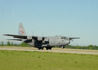 An Air Force Reserve aircrew flying a C-130 Hercules assigned to the 910th Airlift Wing, Youngstown Air Reserve Station, Ohio, takes off to begin its anti-mosquito egg spray mission on June 6, 2013, on Grand Forks Air Force Base, N.D. To allow the mosquito egg spray to effectively be dispersed, it is dumped through a pressurized set of nozzles located on both sides of the rear end of the aircraft.. (U.S. Air Force photo/Airman 1st Class Zachiah Roberson)