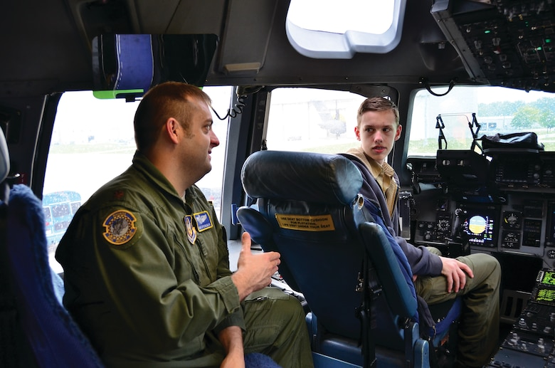 WRIGHT-PATTERSON AIR FORCE BASE, Ohio - Maj. Josh Springman, 89th Airlift Squadron pilot, shows a Boy Scout the flight deck of a C-17 Globemaster III during the 445th Airlift WIng's annual Scouts Day May 18. (U.S. Air Force photo/Staff Sgt. Amanda Duncan)