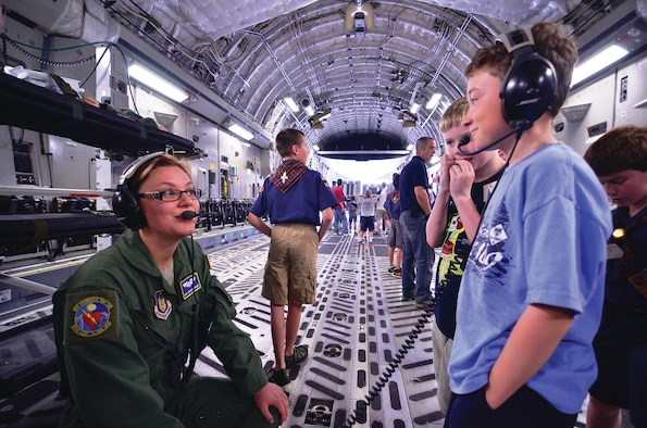 WRIGHT-PATTERSON AIR FORCE BASE, Ohio - Senior Airman Stacey Scharf, 445th Aeromedical Evacuation Squadron technician, demonstrates how to communicate using headsets during the 445th Airlift Wing Scouts Day May 18. (U.S. Air Force photo/Staff Sgt. Mikhail Berlin)