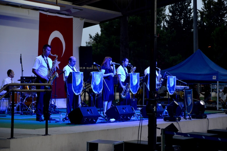 The Turkish Air Force Jazz Band plays for an American and Turkish audience in Arkadas Park June 9, 2013, at Incirlik Air Base, Turkey. The Turkish air force celebrated its 102nd anniversary by inviting members the Incirlik community to view static displays and enjoy a performance from the band. (U.S. Air Force photo by Staff Sgt. Eric Summers Jr./Released)