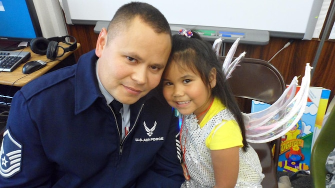 Master Sgt. Edward Timmons, 353rd Special Operations Group, poses for a picture with his daughter, Isabella, 7, recently at his daughter school.  In the past year, Timmons has had two major surgeries and completed radiation treatments to help battle thyroid cancer.  Timmons looks forward to hitting his one year mark in  September, so he can officially be in remission.  (Courtesy photo)